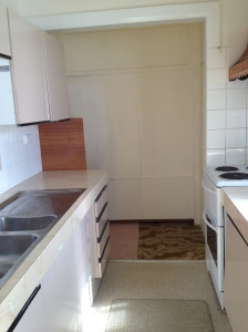 A small galley kitchen replaced the original kitchen out the back. A new kitchen will be relocated in another room.