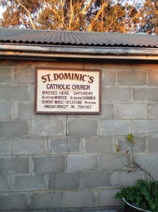 The old Church sign, found in the garage and now housed outside.