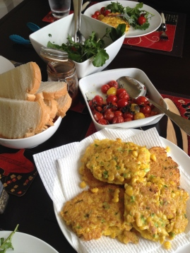 A cheery spread of corn fritters, homemade bread and relishes, Convent garden salad and gr
