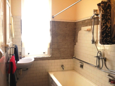 The original bathroom. Drummy and cracked tiles are removed. Hope the ones on order match!