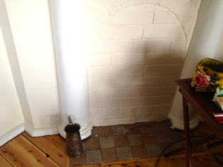 The fireplace in the lounge room has been bricked in for many years but will soon be reopened.