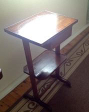 A very rustic French provincial antique walnut side table.