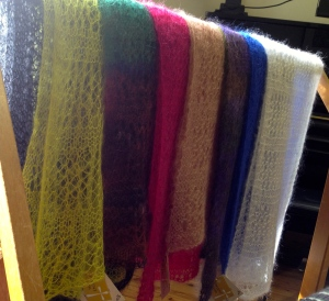 Fishnet lace scarves in a silk/kid mohair blend that could float away in a breeze. These have been popular as gifts, particularly to post.