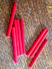 The stunning red glass bugle beads - heavy and you can hear the glass clink!
