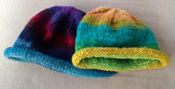 The Roll Brim Beanies in Noro are one of our popular sellers with both adults and kids.
